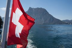 Flag Switzerland on the water in the lake stock photo