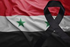 Flag of syria with black mourning ribbon Stock Photo