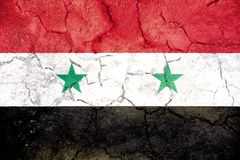 Flag of Syria painted on cracked ground royalty free stock photo