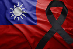 Flag of taiwan with black mourning ribbon. Waving national flag of taiwan with black mourning ribbon Royalty Free Stock Photography