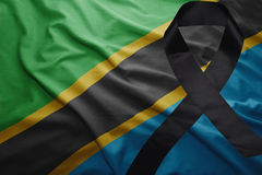 Flag of tanzania with black mourning ribbon Stock Photos