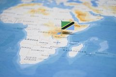 The Flag of tanzania in the world map royalty free stock photo