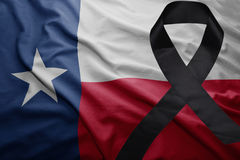 Flag of texas state with black mourning ribbon Stock Photo