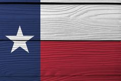 Flag of Texas on wooden plate background. Grunge Texas flag texture. royalty free stock image