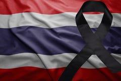 Flag of thailand with black mourning ribbon. Waving national flag of thailand with black mourning ribbon Stock Photos