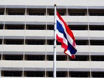 Flag of thailand blowing in the wind. In front tower Royalty Free Stock Image
