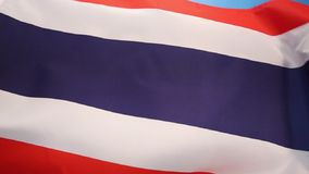 Flag of Thailand - South East Asia. The flag of the Kingdom of Thailand. The design was adopted on 28 September 1917, according to the royal decree issued by stock footage