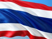 Flag of Thailand waving in the wind against deep blue sky. High quality fabric stock image
