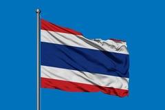 Flag of Thailand waving in the wind against deep blue sky. Thai flag stock photography