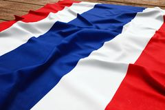 Flag of Thailand on a wooden desk background. Silk Thai flag top view stock photo