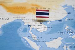 The Flag of thailand in the world map stock images