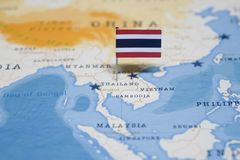 The Flag of thailand in the world map stock photography