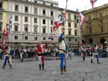 Flag throwing in Florence, Italy. FLORENCE, ITALY: JUNE 22. Controversy erupts in Florence over plans to open a fast food restaurant in the historic old city Stock Photos