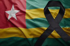 Flag of togo with black mourning ribbon Royalty Free Stock Photography
