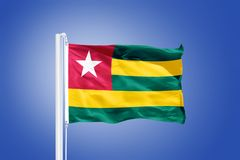 Flag of Togo flying against a blue sky Stock Image