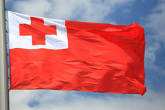 Flag of Tonga. Against the sky Stock Photos