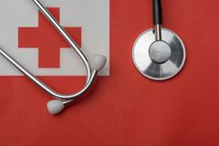 On the flag of Tonga is a stethoscope. The concept of medicine royalty free stock photos