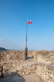 A flag on the top of a castle Stock Photography