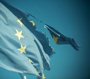 Flag is torn off at side, symbol of problems, decay, disintegration, decomposition, breakdown. European union twelve. Star flag torn and with knots in wind on stock images
