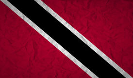 Flag of Trinidad with the effect of crumpled paper and grunge Stock Image