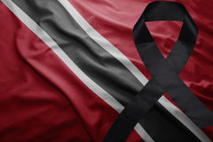 Flag of trinidad and tobago with black mourning ribbon Royalty Free Stock Photography