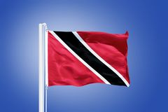 Flag of Trinidad and Tobago flying against a blue sky Royalty Free Stock Photography