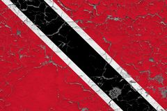 Flag of Trinidad And Tobago painted on cracked dirty wall. National pattern on vintage style surface royalty free illustration