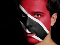 Flag of Trinidad and Tobago. Painted on a Face of a Young Man Stock Photos