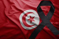 Flag of tunisia with black mourning ribbon Royalty Free Stock Photography