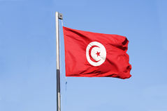 Flag of Tunisia is on blue sky Stock Photo