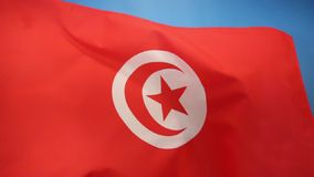 Flag of Tunisia. The current official flag of Tunisia dates from 1999. The star and crescent moon recalls the Ottoman flag and is therefore an indication of stock video footage