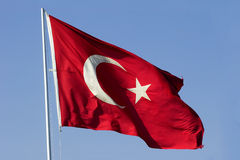 Flag of Turkey. National flag of Republic of Turkey waving against blue sky. Clipping Path included to easy replace background royalty free stock photography