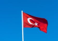 Flag of Turkey on blue sky Royalty Free Stock Photos
