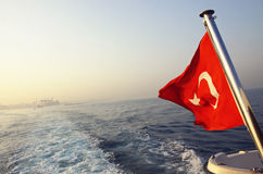 Flag of Turkey on a boat in Bosphorus strait Stock Photos