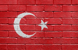 Flag of Turkey on a brick wall. Flag of Turkey painted onto a grunge brick wall royalty free stock photos