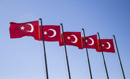 Flag of turkey. Colorful flag of turkeywithmoon and star on blue sky background royalty free stock photography
