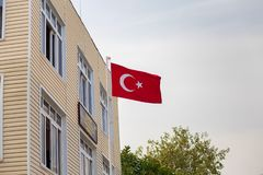 The flag of Turkey develops on wind. The red flag of Turkey develops on wind royalty free stock images