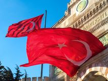 Flag of Turkey fluttering in the wind. Red Turkish flag above the entrance to the University of Istanbul royalty free stock images