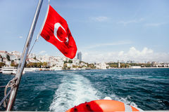 Flag of Turkey and lifebuoy on back of a boat in Bosphorus strait, Istanbul, Turkey stock photo