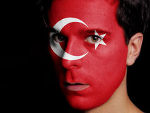 Flag of Turkey. Painted on a Face of a Young Man royalty free stock photography