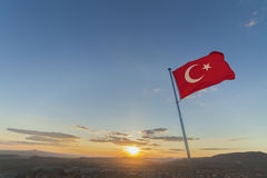 Flag of Turkey on pole during sunset. On the heights of Ortahisar Castle during the sunset stock images