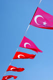 The Flag of Turkey. Turkish flags on a rope against blue sky royalty free stock photography