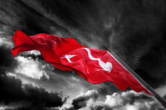 Flag of Turkey waving against black and white sky Royalty Free Stock Image