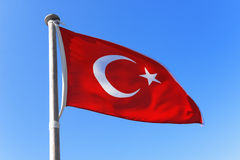 Flag of Turkey. Waving against blue sky stock photo