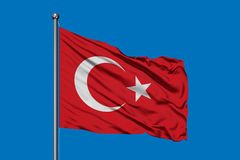 Flag of Turkey waving in the wind against deep blue sky. Turkish flag royalty free stock photos