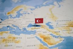 The Flag of turkey in the world map.  stock photography
