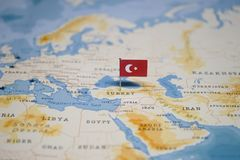 The Flag of turkey in the world map.  royalty free stock images