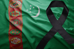 Flag of turkmenistan with black mourning ribbon. Waving national flag of turkmenistan with black mourning ribbon Stock Photography