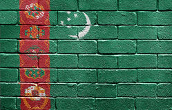 Flag of Turkmenistan on brick wall Stock Images