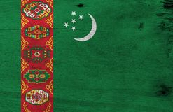 Flag of Turkmenistan on wooden plate background. Grunge Turkmenistan flag texture. Flag of Turkmenistan on wooden plate background. Grunge Turkmenistan flag stock photography